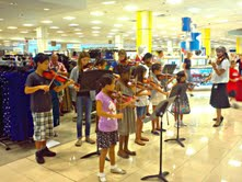 Macy's asked the students to play inside their store as well for the encore! Keep up the great work, students!