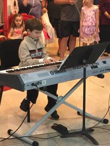 little piano student